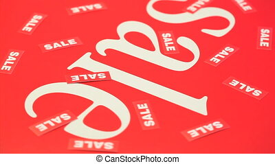 "Several words ""sale"" turning with a red background"