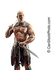 Severe barbarian in leather costume with sword. Portrait of balded muscular gladiator. Studio shot. Isolated on white background