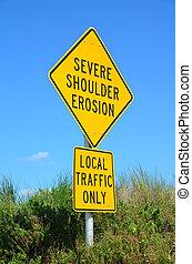 Severe beach erosion sign