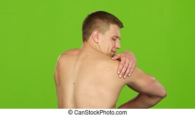 Severe pain in shoulder, man suffering from having painful...