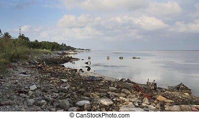 Severely Polluted Rocky Beach on Maafushi Island, Maldives -...