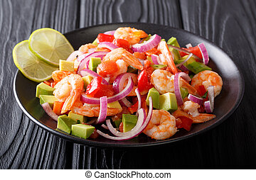 Seviche from marinated shrimp with avocado, pepper, tomatoes...