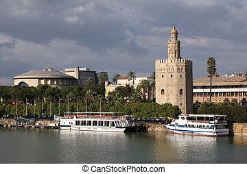 Seville, Spain - river Guadalquivir view with famous Golden ...