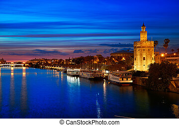 Seville sunset skyline torre del Oro in Sevilla Andalusia ...