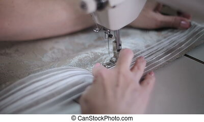 Sew a dress in a textile factory