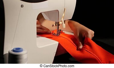 Sew on a sewing machine. Close up