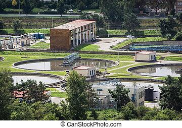 Sewage treatment plant - Round settlers at sewage treatment...