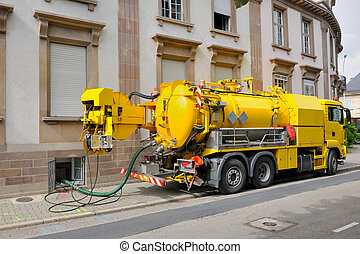Sewage truck working in urban city environment - Sewage -...