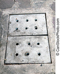 Sewer manhole on the urban asphalt road