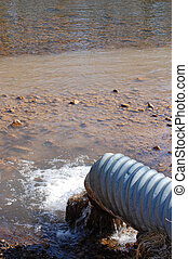 sewer pipe polluting river - sewer pipe draining water,...