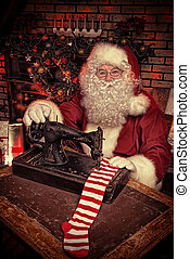 sewing a sock - Santa Claus is sewing on a sewing machine...