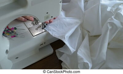 Sewing a white sheet