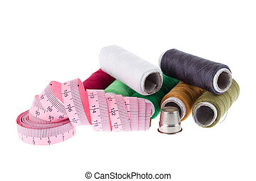 Sewing accessories on white background