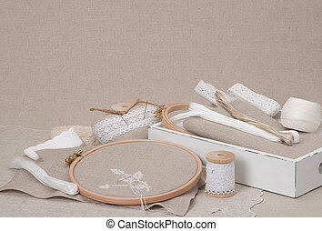 Sewing And Embroidery Craft Kit. Natural Linen Background