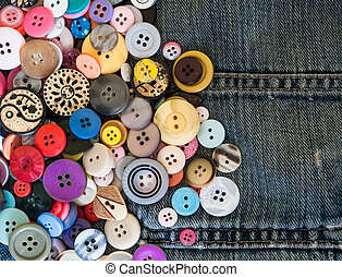 sewing buttons on denim jeans