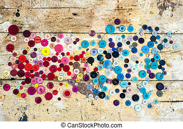 Sewing buttons on grunge background