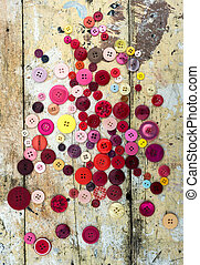 Sewing buttons on grungy background