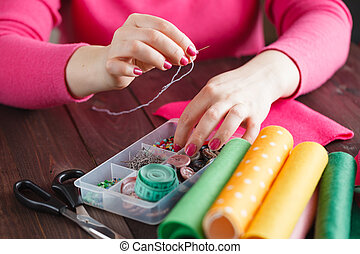 Sewing craft needle textile thread in human finger