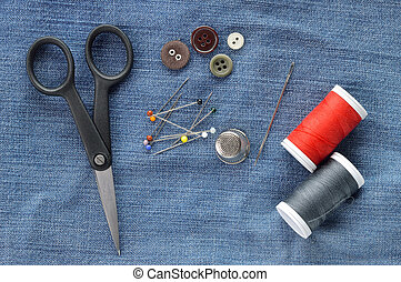 Sewing kit on jeans background.