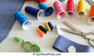 Sewing kit, sewing scissors, bobbins with thread, pincushion...