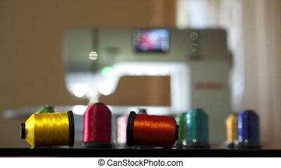 Sewing machine and spools with thread - Sewing machine at...