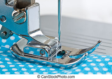 Sewing Machine - Close-up of sewing machine and fabric