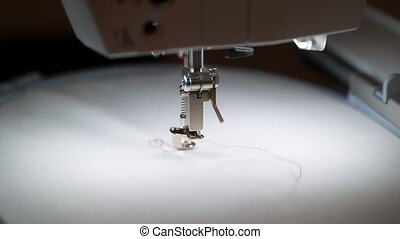 Sewing machine embroidery red word love on white textile