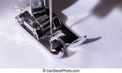 Sewing machine makes the zigzag stitch. Close. Slow motion -...