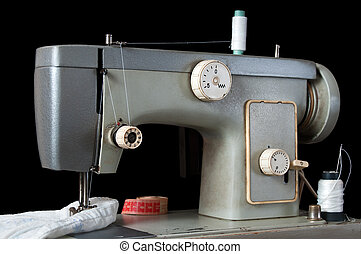 sewing machine on black background