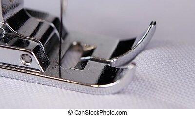 Sewing machine, sewing screening process. Close up. Slow motion