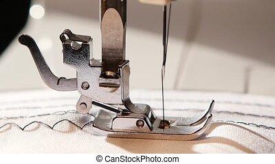 Sewing machine sews a zigzag stitch. Slow motion - Sewing...