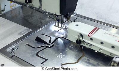 Sewing machine stitching on metal patterns
