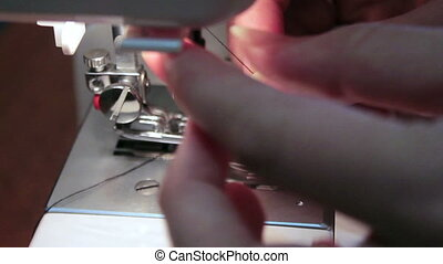 sewing machine thread a needle