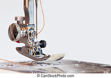 Sewing machine with thread in needle background