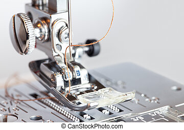 Sewing machine with thread in needle close-up