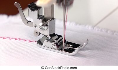 Sewing machine. Zigzag seam with different thread tension....