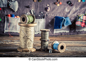 Sewing mat made of buttons, needles and threads in tailor...