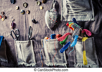 Sewing mat with threads, scissors and buttons in tailor workshop