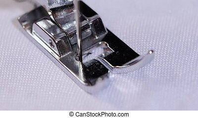 Sewing needle does figured seam. Slow motion - Sewing needle...