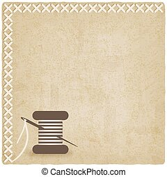sewing old  background with spool of thread and needle