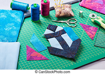 Sewing patchwork of block anchor surrounded by accessories
