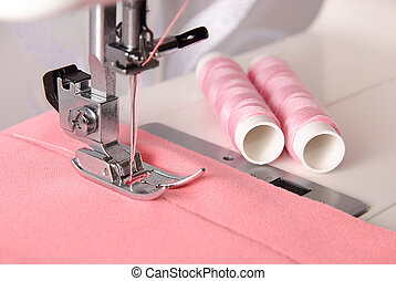 sewing process of rosy cloth on the machine and two bobbins...