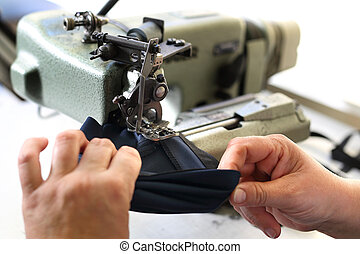Sewing. Seamstress on the machine.
