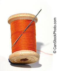 Sewing spool. - Sewing spool with a needle. A sewing needle....