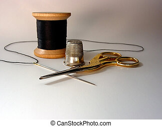 A spool of thread, thimble, scissors, and threaded needle for mending and sewing.