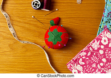Sewing supplies on a wooden background 1