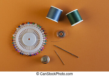 Sewing Supplies on Orange Background