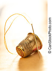 Sewing thimble and needle with thread - Metal sewing thimble...