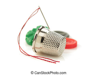 sewing thimble and thread with needle