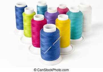 Sewing Threads - group of colorful sewing threads on white...